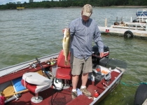 jim in boat w walleye